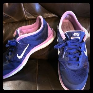 Blue and pinkish purple Nike sneakers